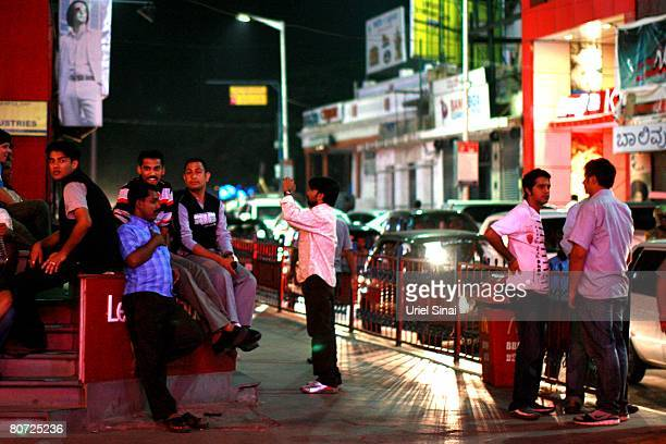 Locals hang out at the night club area on April 12 2008 in Bangalore India Many residents work for multinational cooperations and the economy is...