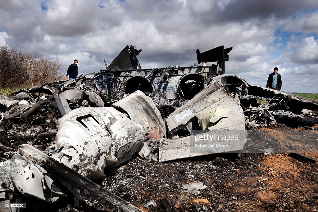 Locals inspect an American F15 E Strike Eagle jet that crashed in a field Libyan rebels fought a bloody 9 month war that eventually toppled the...