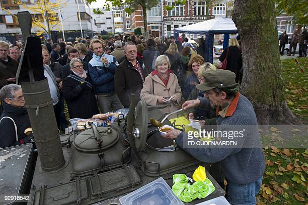 Locals join in the celebration of the 20th anniversary of the Fall of the Berlin Wall with bratwurst goulash soup and beer at the German embassy in...