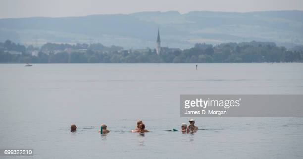 Locals keeping cool in Lake Zug on the longest day of 2017 on June 21 2017 in Zug Switzerland The summer solstice was celebrated in the picturesque...