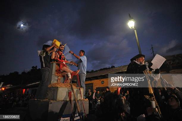 Locals look at a figure that represents the devil before being set ablaze on December 7 in municipality Antigua Guatemala Sacatepequez departament...
