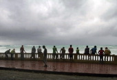 Locals look at high waves caused by Tropical Storm Isaac in Bahoruco southwest Dominican Republic on August 24 2012 Isaac was packing maximum...