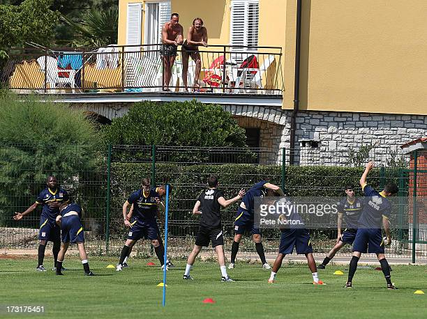 Locals look on as Northampton Town players take part in a training session during PreSeason Training on July 3 2013 in Novigrad Croatia