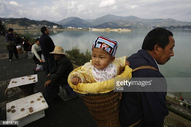 Locals look on near to the Three Gorges Dam on November 8 in Zigui County Yichang Hubei Province China When reaching full capacity in 2012 the...
