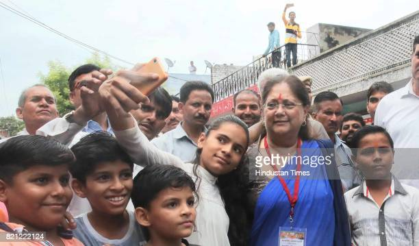 Locals of Sushilpura greet CM Vasundhara Raje who had accompanied BJP National President Amit Shah on a lunch at a dalit's home on the concluding day...