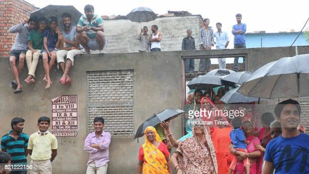 Locals of Sushilpura slum await BJP National President Amit Shah who visited a dalit's home for lunch along with Chief Minister Vasundhara Raje...