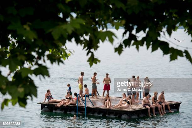 Locals on a pontoon enjoying the hot weather on the longest day of 2017 on June 21 2017 in Zug Switzerland The summer solstice was celebrated in the...