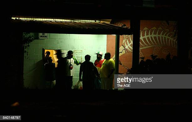 Locals order low alcohol beer through the back window of the pub Palm Island in northern Queensland An alcohol management plan was imposed on the...