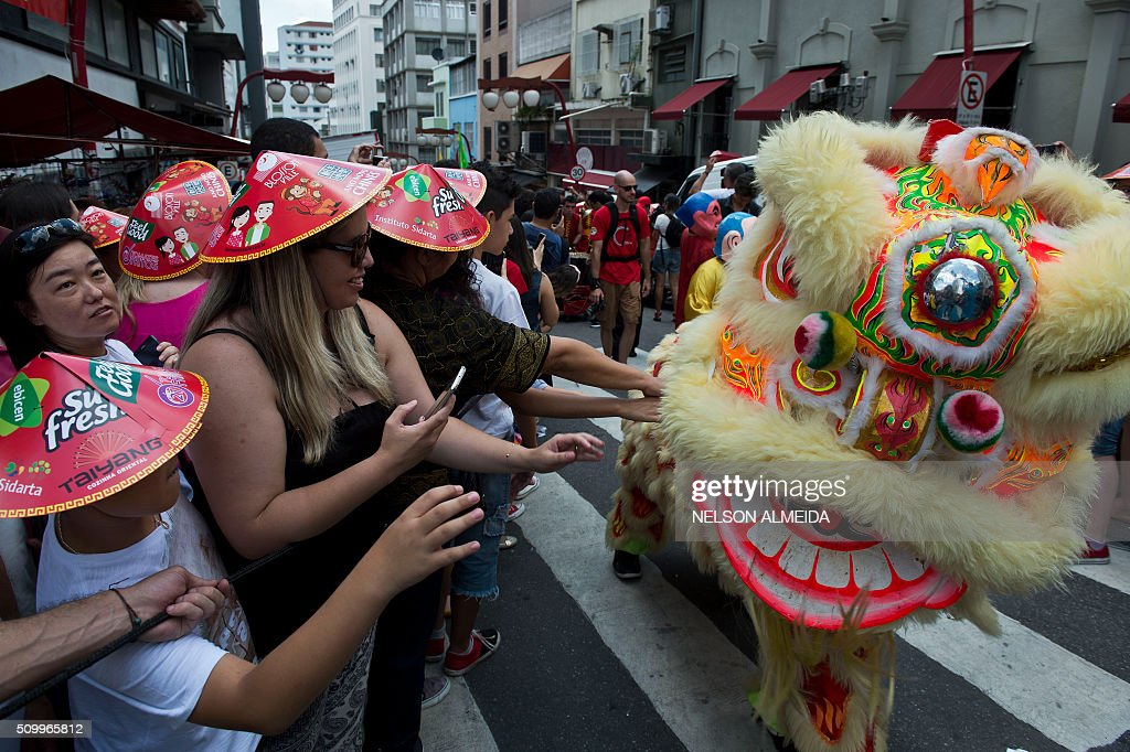Locals perform a dragon dance during the Chinese lunar new year celebrations at Liberdade district in Sao Paulo Brazil, on February 13, 2016. AFP PHOTO / NELSON ALMEIDA / AFP / NELSON ALMEIDA