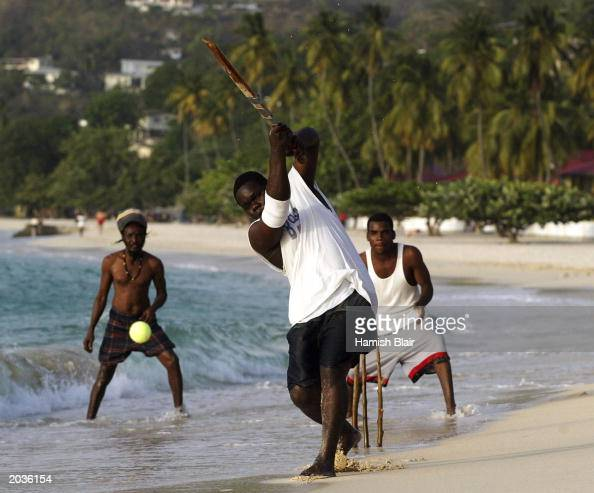 Locals play cricket on May 28 2003 on the beach in St George's Grenada