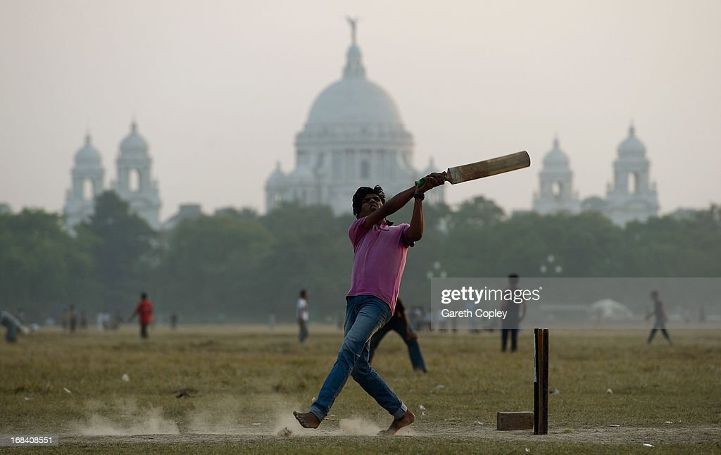 Locals play cricket on the Kolkata Maidan on December 2, 2012 in Kolkata, India.