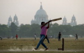 Locals play cricket on the Kolkata Maidan on December 2 2012 in Kolkata India