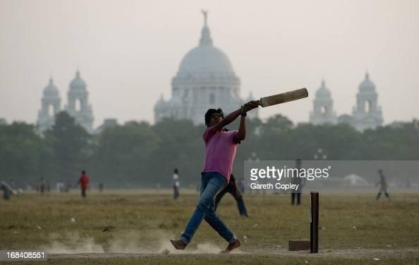 Locals play cricket on the Kolkata Maidan on December 2 2012 in Kolkata India