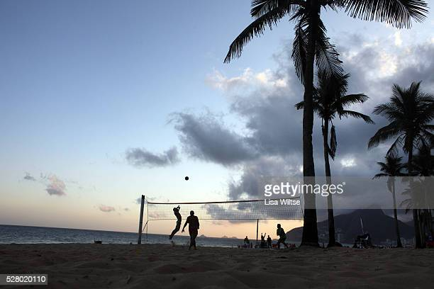 Locals play foot volley a hybrid game combining beach volley ball and football at Copacabana beach Rio de Janeiro Brazil 5th July 2010 Photo by Lisa...