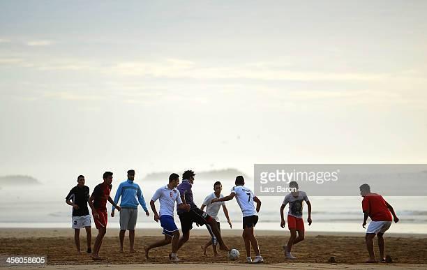 Locals play football on the beach at Agadir bay on December 13 2013 in Agadir Morocco