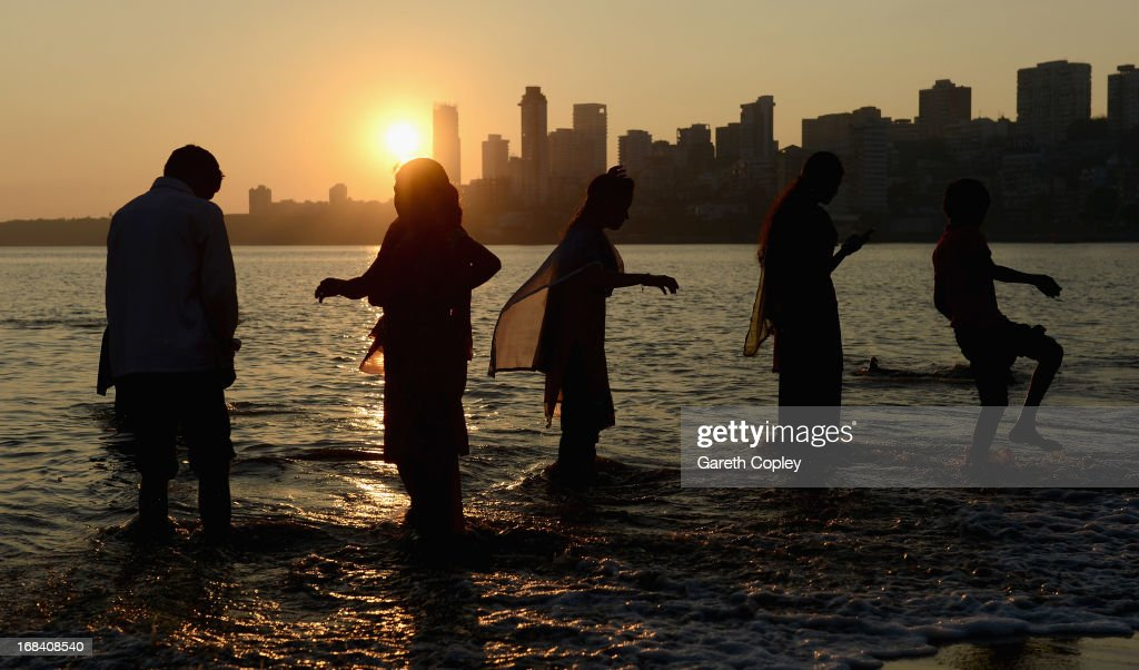 Locals play in the sea at Chowpatty Beach on November 23, 2012 in Mumbai, India.