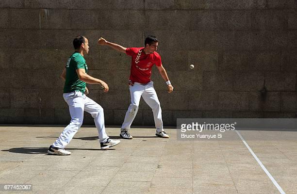 Locals playing Basque Pelota on street court