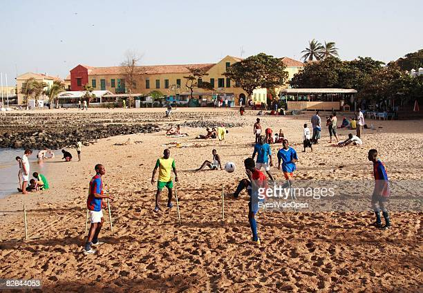 Locals playing beachsoccer and tourists at a beach on the Ile De Gore island on December 27 2007 near Dakar Republic of Senegal The Ile De Gore...
