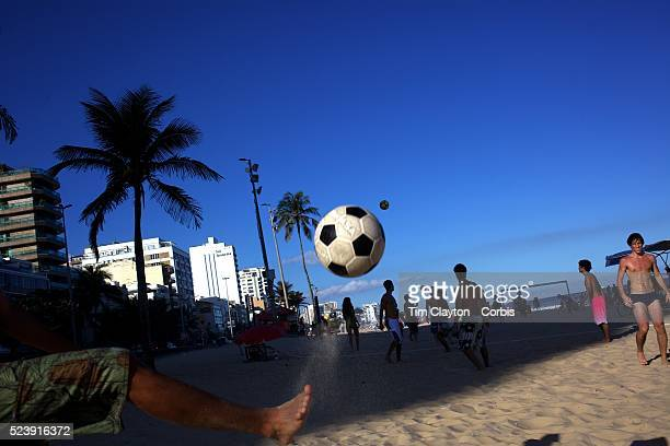 Locals practice foot volley a hybrid game combining beach volley ball and football at Ipanema beach Rio de Janeiro Brazil 5th July 2010