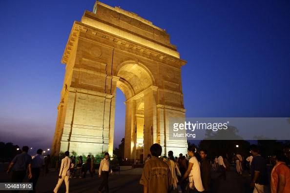 Locals relax before the Opening Ceremony takes place at India Gate on October 3 2010 in Delhi India