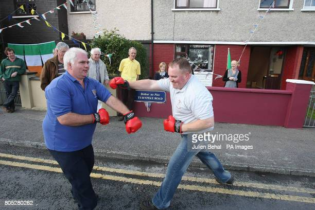 Locals shadow boxing on Turnpike road as they wait for boxing legend Muhammad Ali with his wife Lonnie Ali in Ennis CoClare Ireland unveiling the...