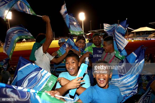 Locals show their support for the Blues before the round 15 Super Rugby match between the Blues and the Reds at Apia Park National Stadium on June 2...