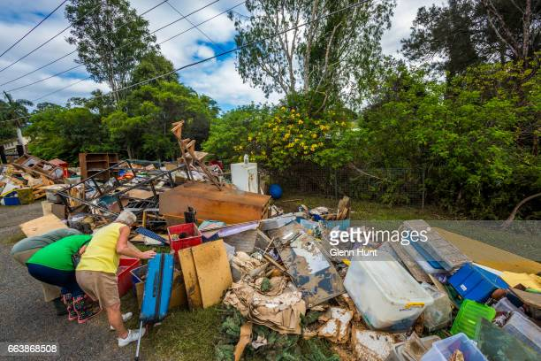 Locals sift through belongings at Eagleby where houses were damaged by floodwater on April 3 2017 in Eagleby Australia Heavy rain caused flash...
