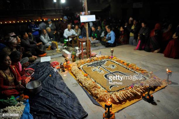 Locals singing traditional singing religious hymns on the night of Sakimana Punhi at Bhaktapur Nepal on Saturday November 04 2017 Each year on the...