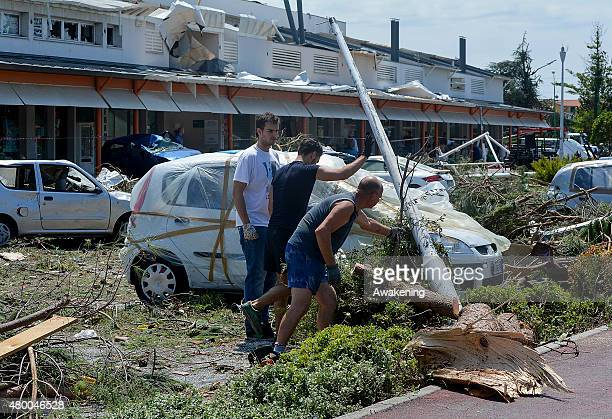 Locals take part in a major operation to restore essential services after last night tornado on July 9 2015 in Venice Italy A tornado swept through...