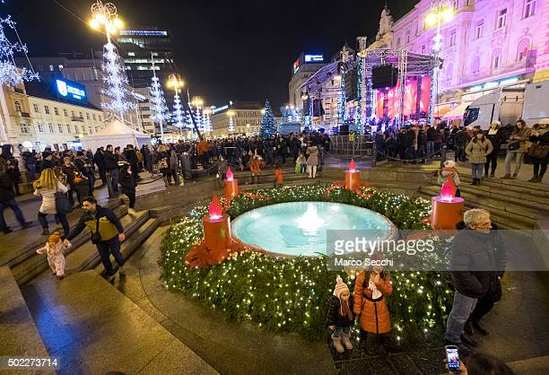 Locals take pictures and selfies at the Christmas decorated fountain in the main square on December 22 2015 in Zagreb Croatia Zagreb was voted last...