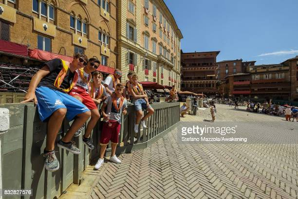 Locals take place ahead of today's Palio on August 16 2017 in Siena Italy The Palio is the most famous event in Siena and is a horse race that is...