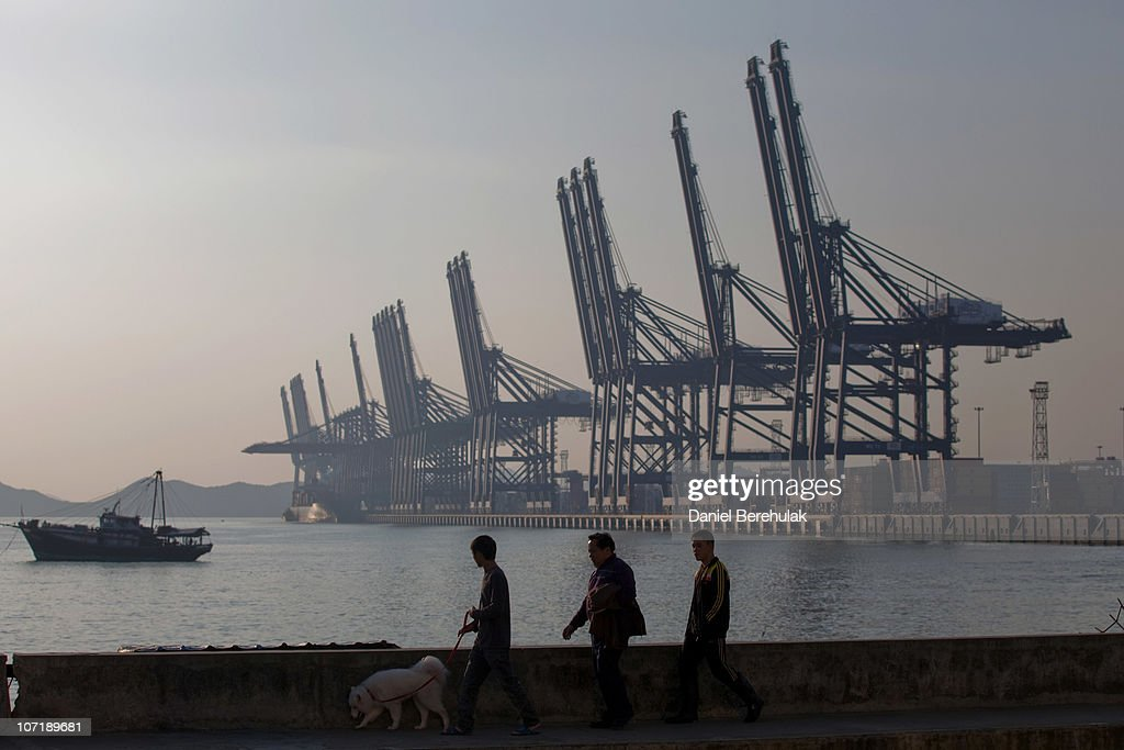 Locals take their morning walk near to Shenzhen Port on November 28, 2010 in Shenzhen, China. According to the US Commercial Service, Shenzhen is one of the fastest growing cities in the world. Home of the Shenzhen Stock Exchange and the headquarters of numerous technology companies, the now bustling former fishing village is considered southern China's major financial centre.