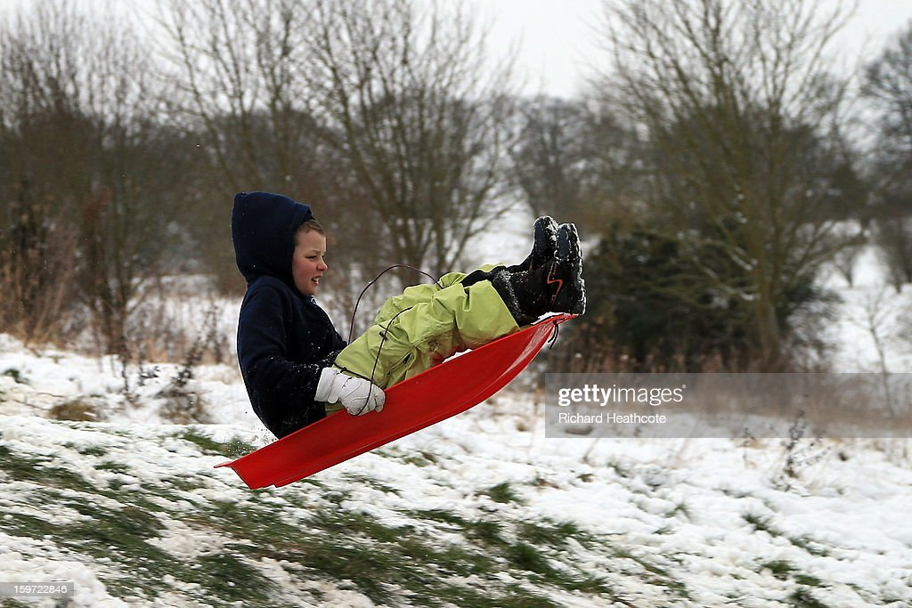 Locals use the snow covered Wycombe Heights Golf Course for snowboarding and sledging on January 19, 2013 in High Wycombe, United Kingdom.