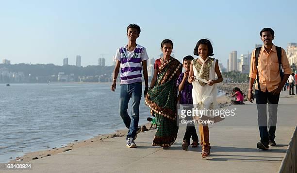 Locals walk along Marine Drive on November 22 2012 in Mumbai India