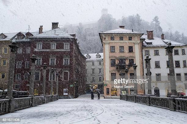 Locals walk on Cevljarski Most on January 13 2017 in Ljubljana Slovenia Most of Slovenia was covered by heavy snowfalls for the first time this winter