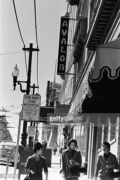 Locals walk past the Avalon Ballroom one of the rock music palaces in San Francisco California in the early summer 1967
