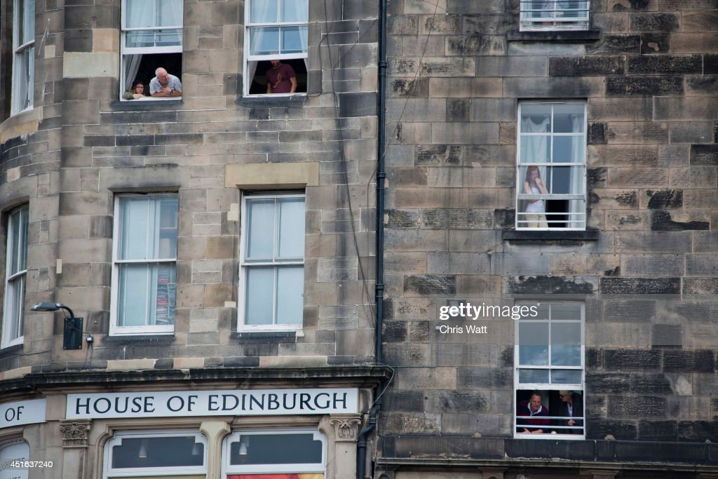 Locals watch the Thistle Service at St Giles' Cathedral from vantage points on July 3, 2014 in Edinburgh, Scotland. The Queen and The Duke of Edinburgh have spent the week in Scotland attending various events and staying at the Palace of Holyroodhouse. The visit comes before the referendum vote on the 18th September.