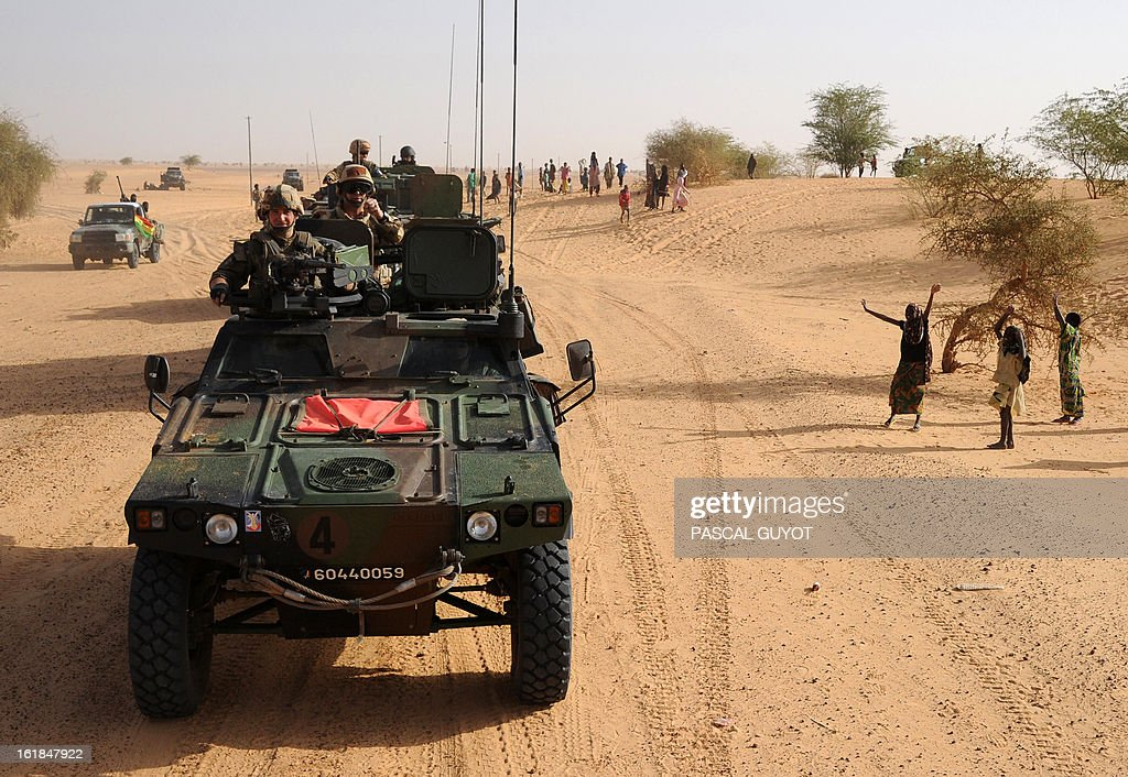 Locals welcome French soldiers as they drive to Bourem northen Mali on February 17, 2013. Leaders in Africa's Sahel region called on Saturday for further efforts to support Mali as they announced new funds to back a West African force in the country. A French-led military intervention launched on January 11 has driven the Islamist rebels in Mali from the towns they controlled, but concerns remain over stability amid suicide attacks and guerrilla fighting. GUYOT