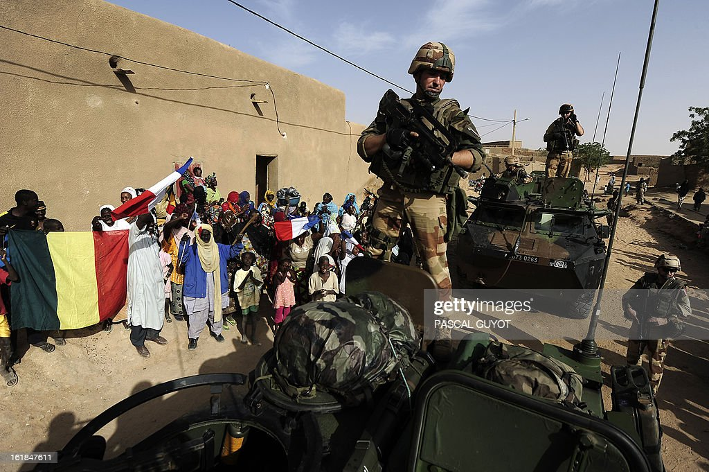 Locals welcome French soldiers in Bourem northen Mali on February 17, 2013. Leaders in Africa's Sahel region called on Saturday for further efforts to support Mali as they announced new funds to back a West African force in the country. A French-led military intervention launched on January 11 has driven the Islamist rebels in Mali from the towns they controlled, but concerns remain over stability amid suicide attacks and guerrilla fighting. GUYOT
