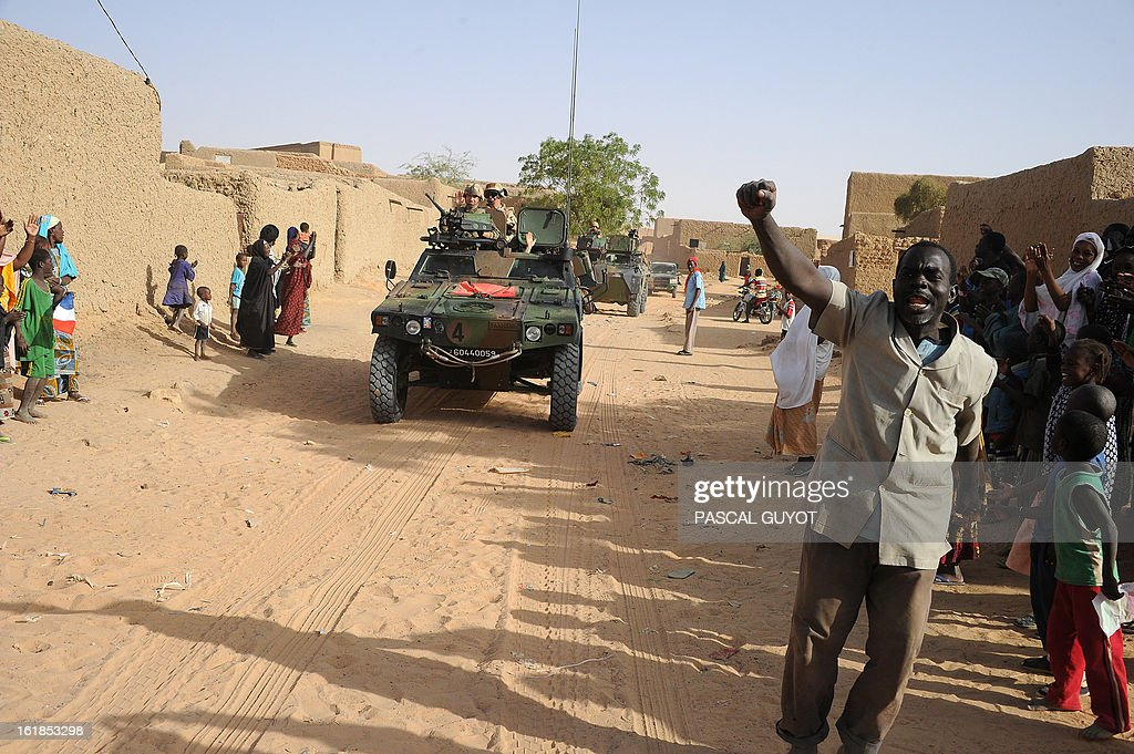 Locals welcome French soldiers in Bourem northen Mali on February 17, 2013. Leaders in Africa's Sahel region called on Saturday for further efforts to support Mali as they announced new funds to back a West African force in the country. A French-led military intervention launched on January 11 has driven the Islamist rebels in Mali from the towns they controlled, but concerns remain over stability amid suicide attacks and guerrilla fighting.