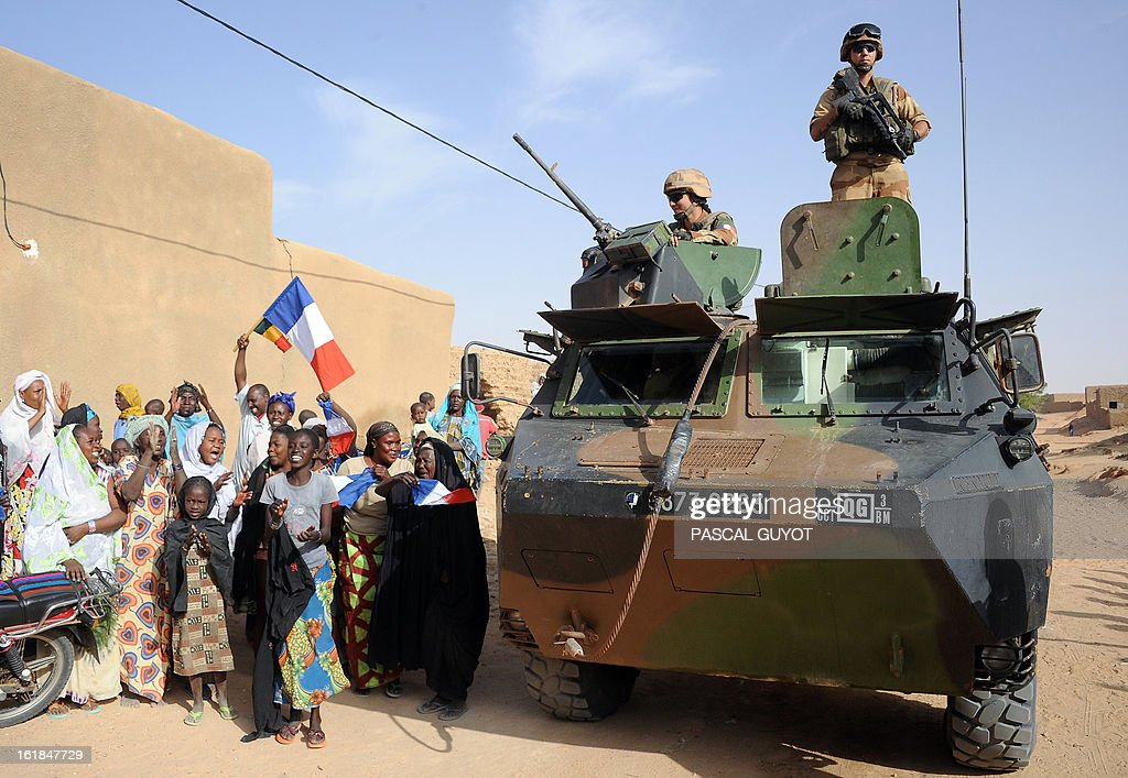 Locals welcome French soldiers in Diabaly northen Mali on February 17, 2013. Leaders in Africa's Sahel region called on Saturday for further efforts to support Mali as they announced new funds to back a West African force in the country. A French-led military intervention launched on January 11 has driven the Islamist rebels in Mali from the towns they controlled, but concerns remain over stability amid suicide attacks and guerrilla fighting. GUYOT