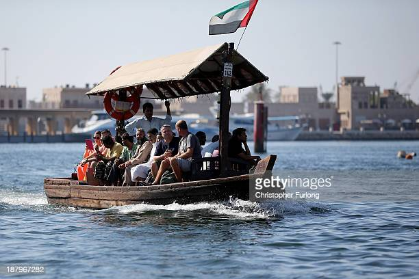 Locas and tourists use a water taxi to cross the Dubai creek on November 13 2013 in Dubai United Arab Emirates Dubai is recovering from its slump...