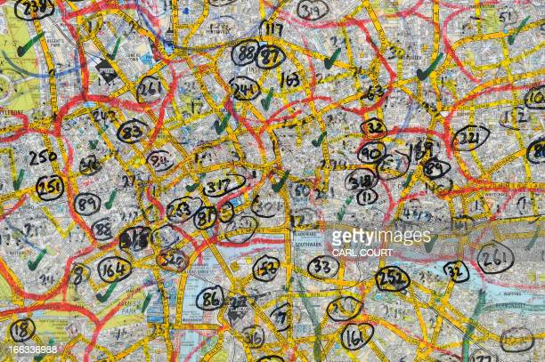 Locations are numbered on a map of central London in a Knowledge test centre in north London on February 28 2013 All London Black Cab drivers are...