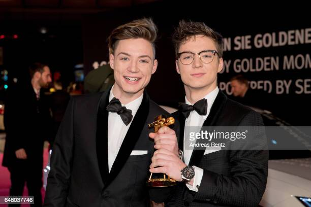 Lochis Heiko and Roman Lochmann pose with their award upon their arrival for the Goldene Kamera on March 4 2017 in Hamburg Germany