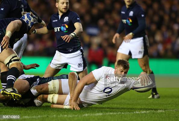 Lock George Kruis of England crashes over to score the opening try during the RBS Six Nations match between Scotland and England at Murrayfield...