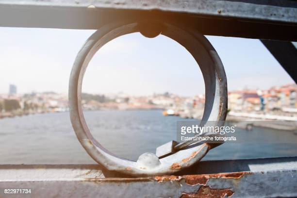 Lock of a couple on a bridge in Porto