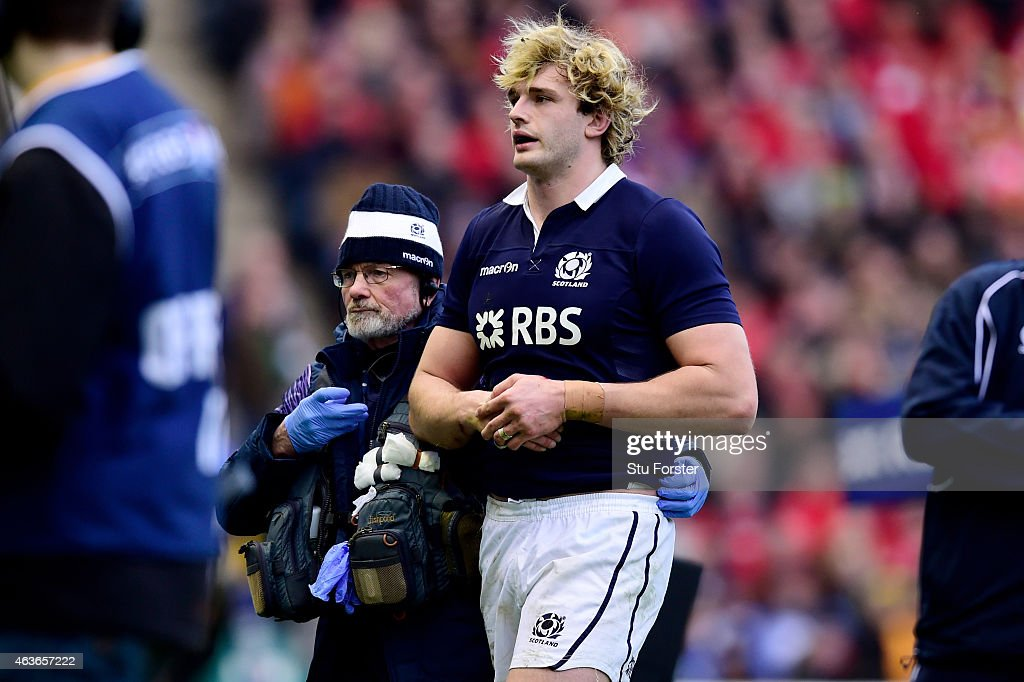 Lock <a gi-track='captionPersonalityLinkClicked' href=/galleries/search?phrase=Richie+Gray+-+Rugby+Player&family=editorial&specificpeople=5907993 ng-click='$event.stopPropagation()'>Richie Gray</a> of Scotland leaves the pitch due to an arm injury during the RBS Six Nations match between Scotland and Wales at Murrayfield Stadium on February 15, 2015 in Edinburgh, Scotland.
