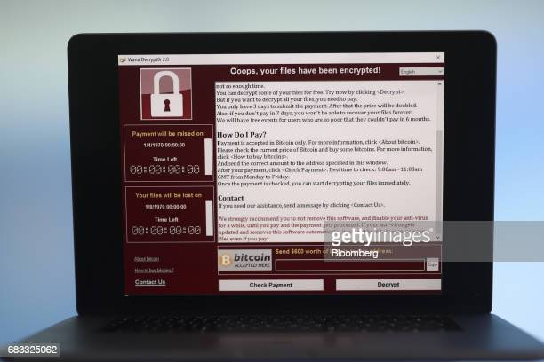 A lock screen from a cyber attack warns that data files have been encrypted on a laptop computer in this arranged photo in London UK on Monday May 15...