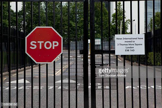 Locked gates at the former News International base in Wapping East London Media mogul Rupert Murdoch moved his British newspapers to 'Fortress...