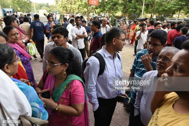 Locker owners gathered at the gate of Bank of Baroda Juinagar Branch after the news of bank robbery spread on November 13 2017 in Navi Mumbai India...